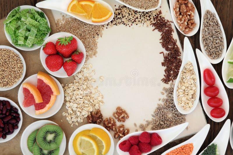 Natural Health Food. Health food selection in porcelain bowls over natural speckled hemp paper notebook stock images