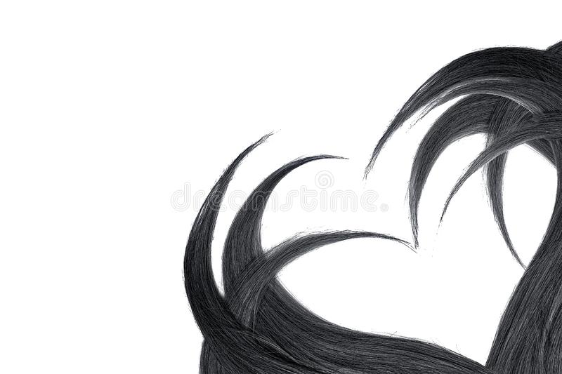 Black hair in shape of heart, isolated on white background. Natural healthy hair isolated on white background. Detailed clipart for your collages and royalty free stock images