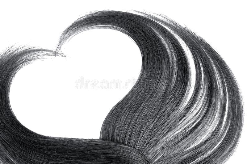 Black hair in shape of heart, isolated on white background. Natural healthy hair isolated on white background. Detailed clipart for your collages and stock photo