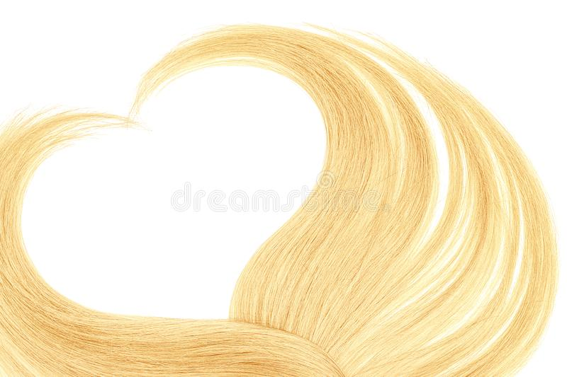 Blond hair in shape of heart, isolated on white background. Natural healthy hair isolated on white background. Detailed clipart for your collages and royalty free stock images