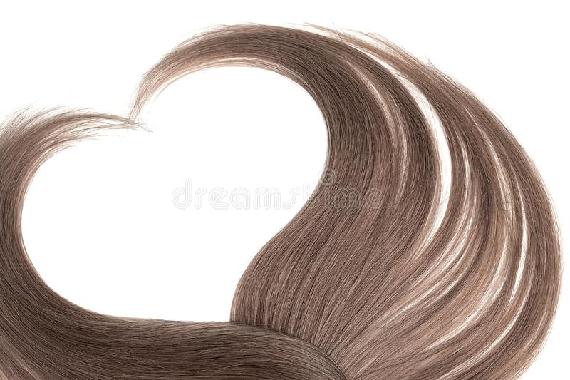 Brown hair in shape of heart, isolated on white background. Natural healthy hair isolated on white background. Detailed clipart for your collages and stock images