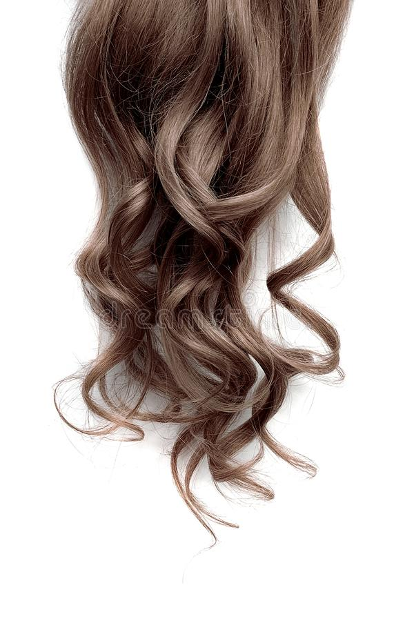 Long wavy brown hair on white background royalty free stock image