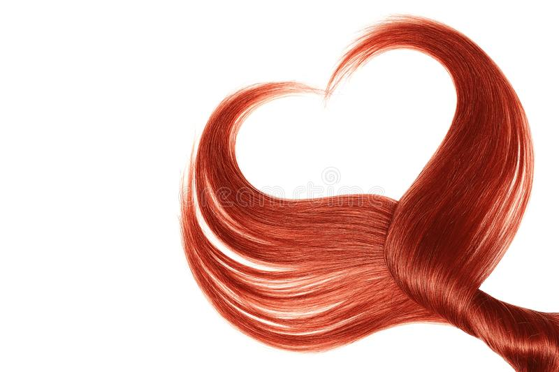 Red hair in shape of heart, isolated on white background. Natural healthy hair isolated on white background. Detailed clipart for your collages and illustrations stock photos