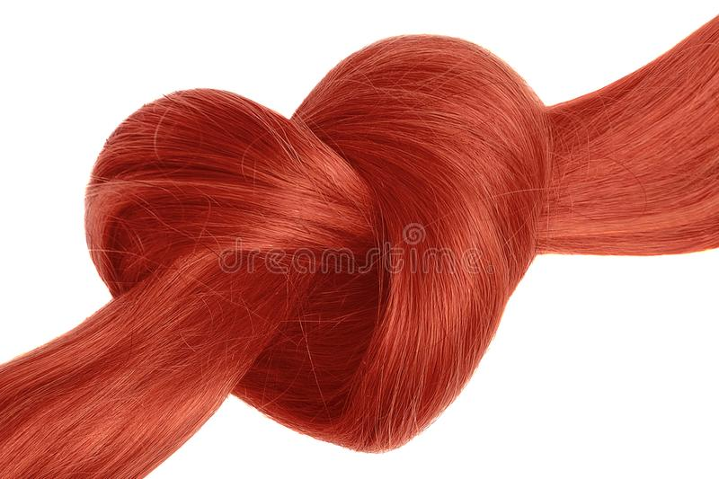 Red hair knot in shape of heart, isolated on white. Natural healthy hair isolated on white background. Detailed clipart for your collages and illustrations stock photos