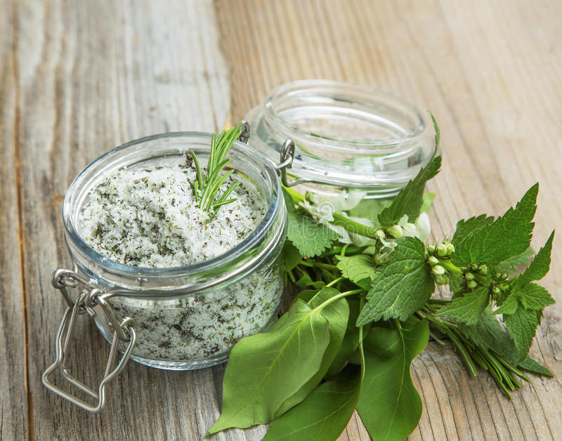 Natural herbal salty scrub with rosemary,organic homemade treatment exfoliator in a jar stock photos