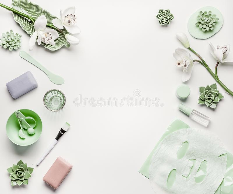 Natural herbal skin care cosmetic setting with accessories and facial calming sheet mask on white. Background, top view, frame, flat lay stock photography