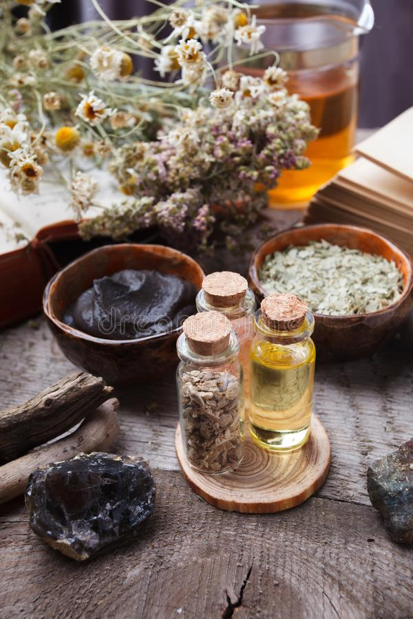 Natural herbal skin care products, top view ingredients. Cosmetic oil, clay, sea salt, herbs, plant leaves stock photo