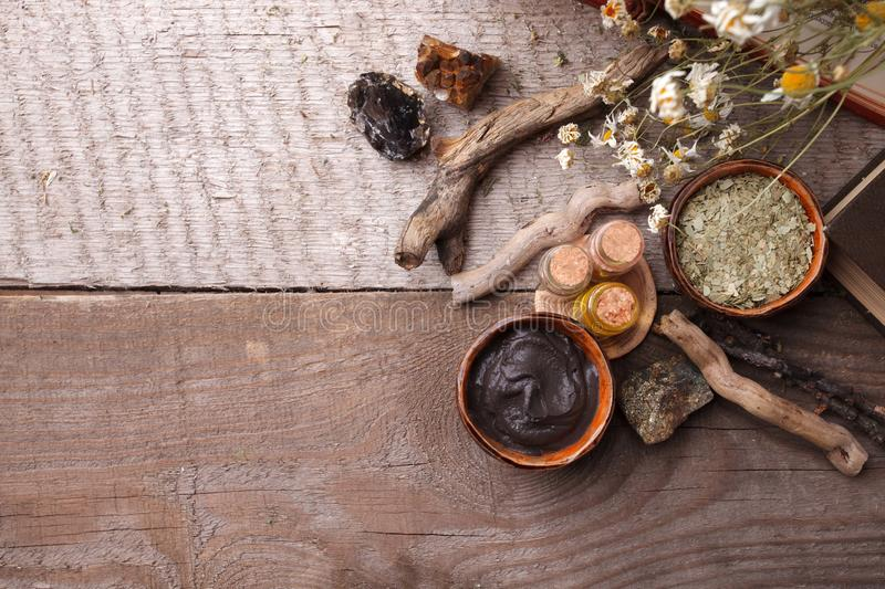 Natural herbal skin care products, top view ingredients. Cosmetic oil, clay, sea salt, herbs, plant leaves royalty free stock photos