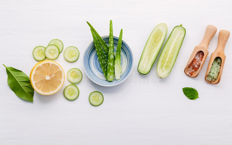 Natural herbal skin care products. Top view ingredients cucumber ,aloe vera ,lemon and himalayan salt on table concept of the best. All natural face moisturizer royalty free stock images