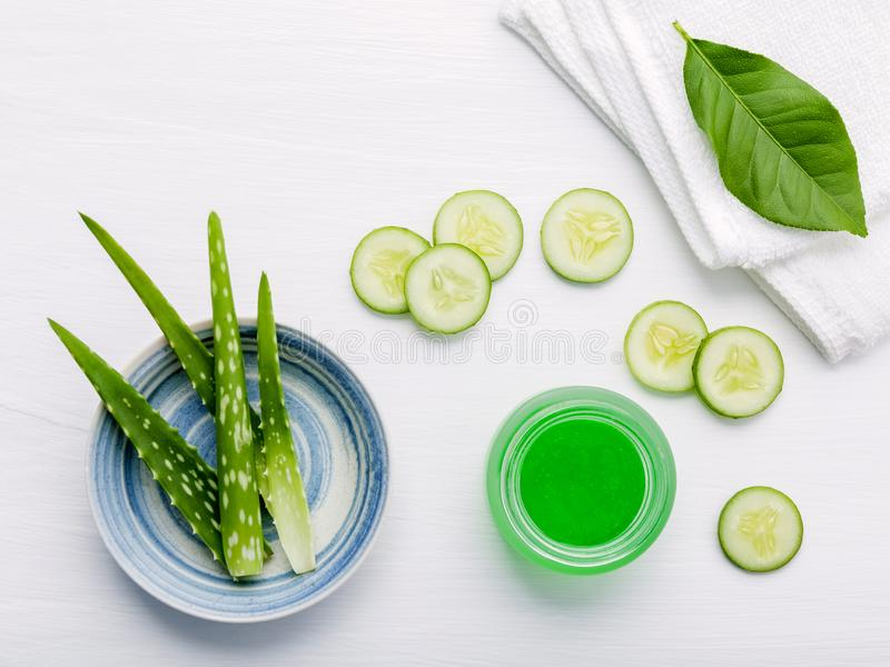 Natural herbal skin care products. Top view ingredients cucumber and aloe vera on table concept of the best all natural face. Moisturizer. Facial treatment royalty free stock photography