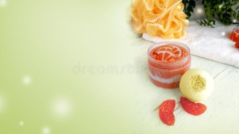 Citrus scrub with spa bomb and homemade soap on green background. stock photography