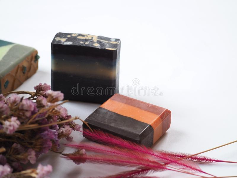 Natural homemade soap with flower decoration on white background royalty free stock images