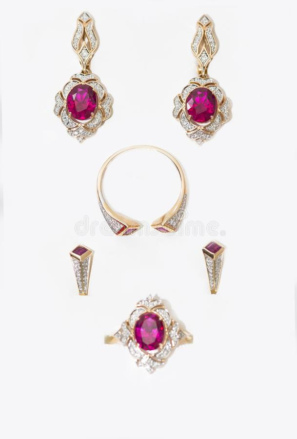 Natural and hydrothermal rubies in gold ornaments. Natural and hydrothermal red rubies in gold ornaments royalty free stock images