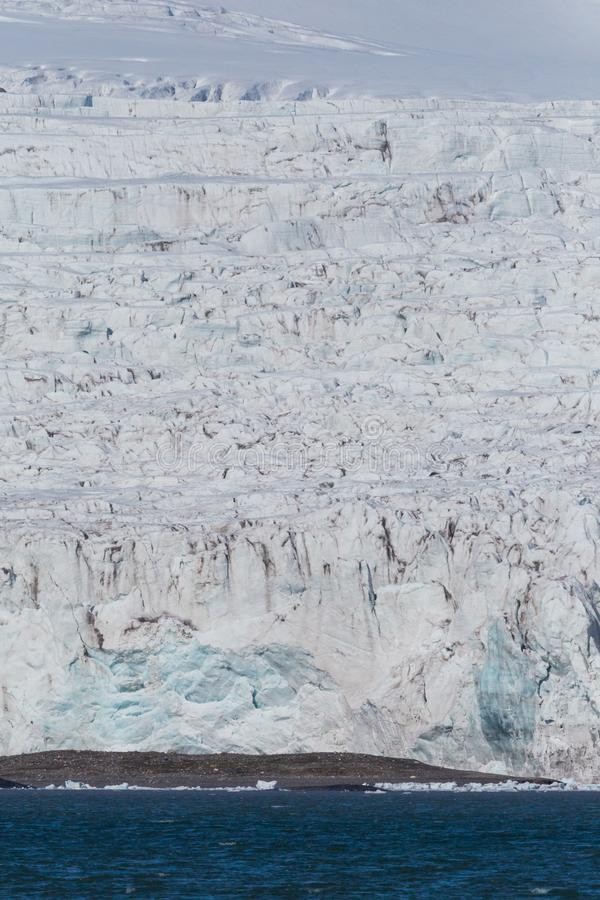 Ice front and crevasses of svalbard Esmarkbreen glacier. Natural ice front and crevasses of svalbard Esmarkbreen glacier royalty free stock photos