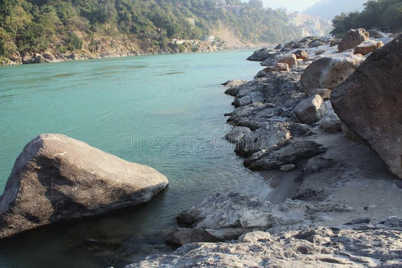 Natural Image. Rishikesh. Rishikesh, a most tranquil place in northern Uttarakhand, surrounded by hills and bisected by the wide and sluggish Ganges, is often royalty free stock photos