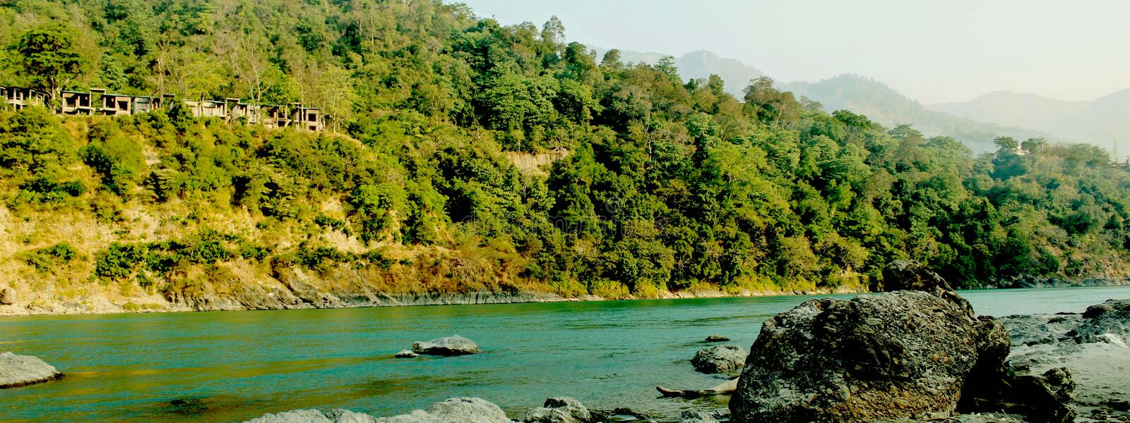 Natural Image. Rishikesh. Rishikesh, a most tranquil place in northern Uttarakhand, surrounded by hills and bisected by the wide and sluggish Ganges, is often stock photos
