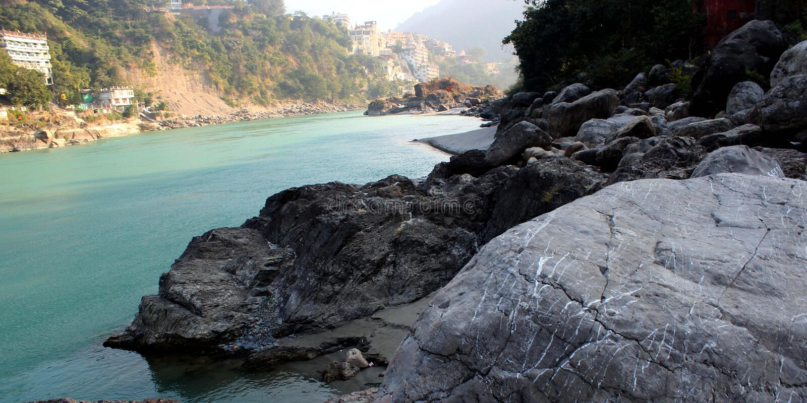Natural Image. Rishikesh. Rishikesh, a most tranquil place in northern Uttarakhand, surrounded by hills and bisected by the wide and sluggish Ganges, is often stock image