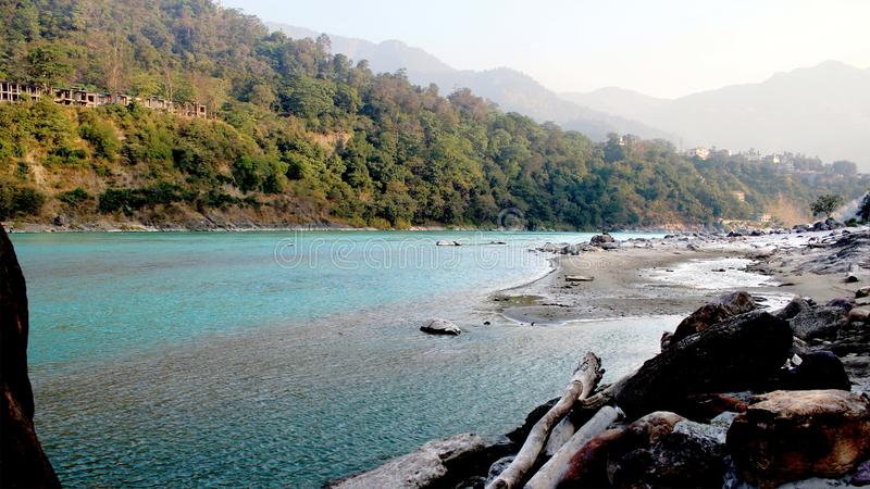 Natural Image. Rishikesh. Rishikesh, a most tranquil place in northern Uttarakhand, surrounded by hills and bisected by the wide and sluggish Ganges, is often royalty free stock photo