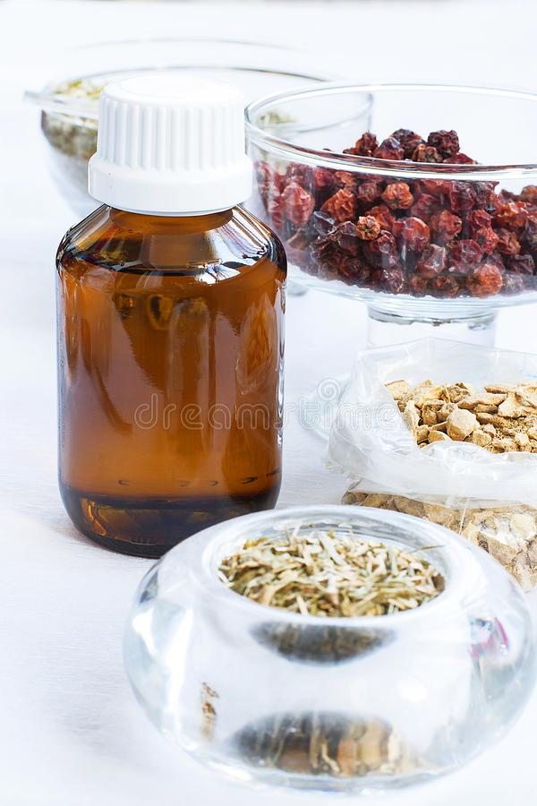 Natural ingredients used for the manufacture of medicines and natural cosmetics. Natural ingredients berries, fruits, flowers, stems, leaves, used for the royalty free stock photos