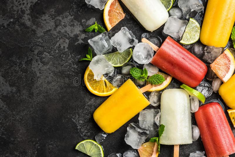 Natural juice ice pops with fruits and mint. Background citrus cold colorful concept cool copyspace dark delicious dessert flat lay flavor flavored food fresh stock images