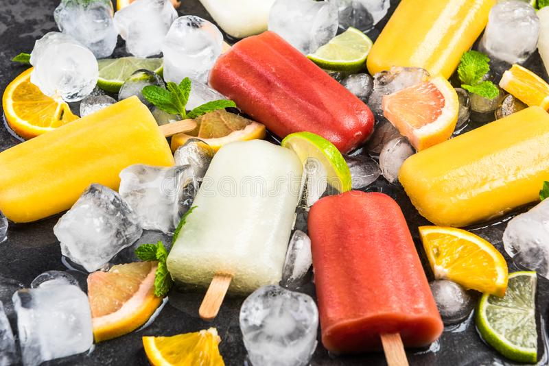 Natural juice ice pops with fruits and mint. Background citrus cold colorful concept cool copyspace dark delicious dessert flat lay flavor flavored food fresh stock photos