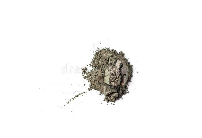 Natural khaki green colored pigment. Loose cosmetic powder. Eyeshadow duochrome prismatic pigment isolated on a white royalty free stock images
