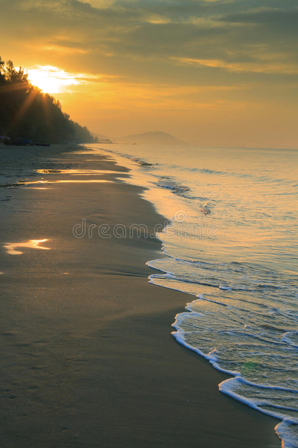 Natural land scape of sun rising on sea beach vertical form stock photos