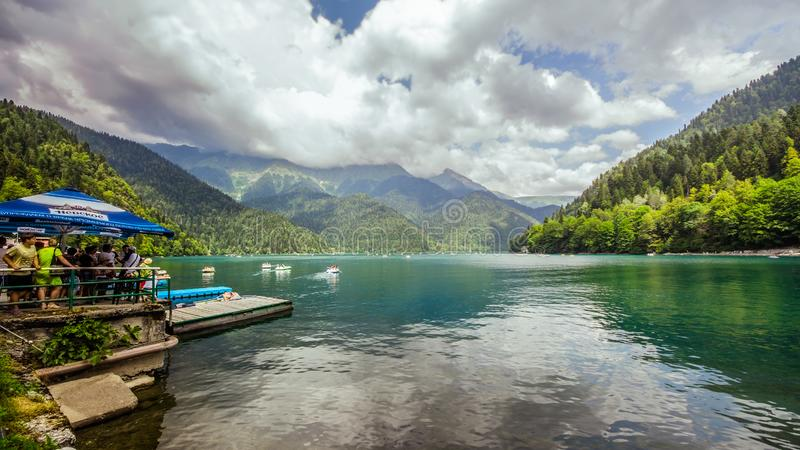 Natural landscape. Panorama view of the lake Small Ritsa. Trees reflecting in the blue from lapis lazuli water. Ritsa National Par royalty free stock images