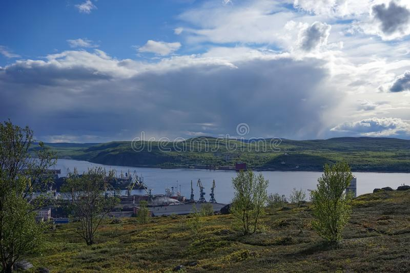 Natural landscape with tundra vegetation overlooking the Kola Bay. Murmansk, Russia-June 5, 2015: Natural landscape with tundra vegetation with views of Kola royalty free stock photography