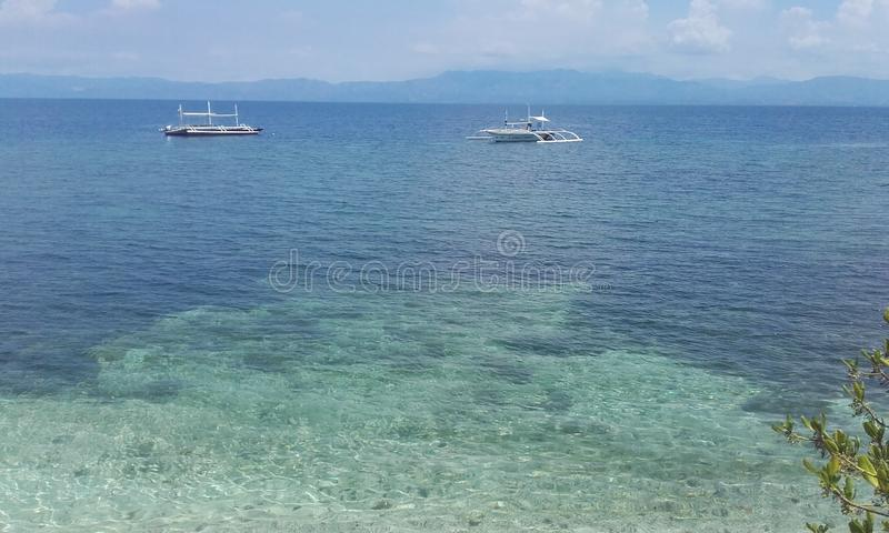 Translucent water Cebu island Philippines. Natural landscapes from Philippines Blue water with boat sunny natural day Cebu island Philippines stock images