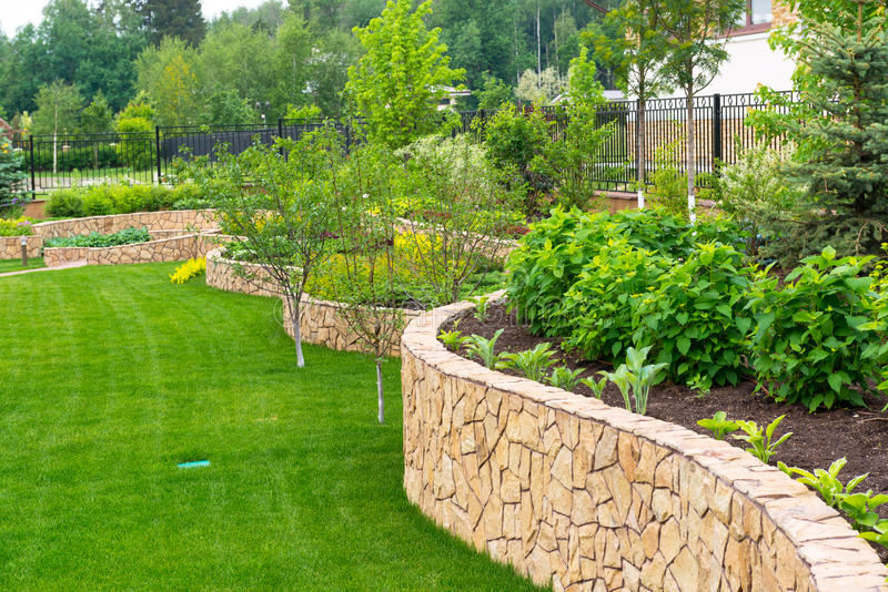 Natural landscaping in home garden royalty free stock image