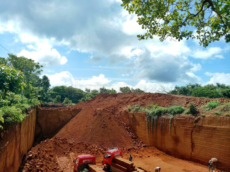 Sunny Day in Kerala, Kannur. Natural laterite stone mining in Kannur Chemperi. sunny blue sky background royalty free stock photography