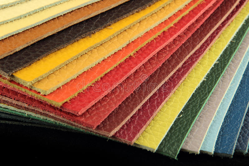 Natural leather upholstery samples in various colors royalty free stock images