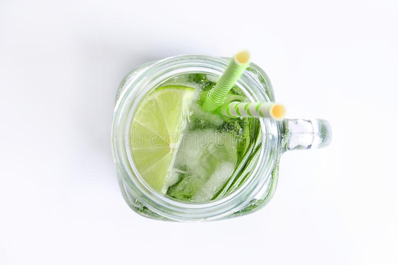 Natural lemonade in mason jar on white background, top view stock photo