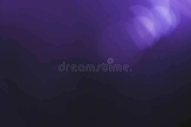 Natural lens flare bokeh blur violet gradient. Natural digital light lens flare. Bokeh blur effect. Black violet color gradient. Spotlight optical effect royalty free stock photo