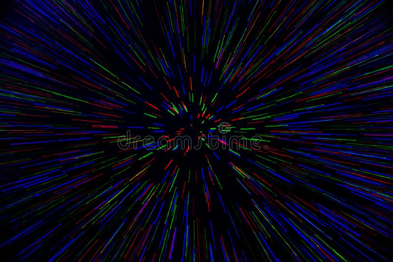 Natural lens zoom explosion radial blurred red green blue dots on black background.  stock photos