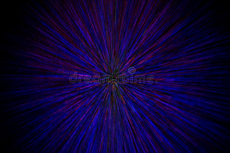 Natural lens zoom explosion radial blurred red green blue dots on black background with selective focus royalty free stock image
