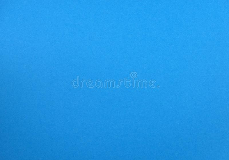 Natural light blue colored paper texture royalty free stock photography