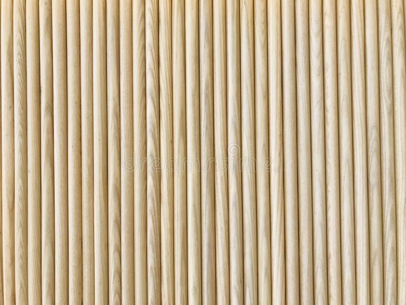 Natural light brown rubber softwood wall. Natural light brown rubber softwood logs attached together as a wall in full frame shot stock photography