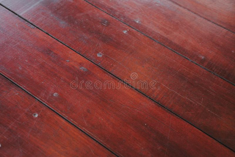 Natural light brown wooden parquet floor boards. Sunny soft yellow texture, copy space perspective background. The Natural light brown wooden parquet floor stock images