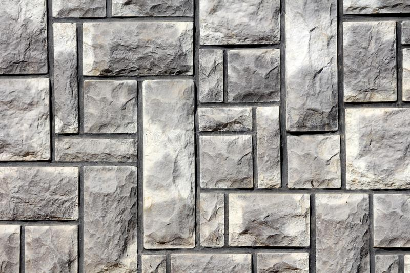 Natural light stone tiles on family house wall texture background wallpaper royalty free stock images
