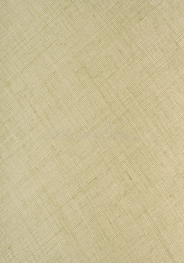 Natural Linen Fabric Background. Natural Tan Linen Fabric Textured Background in a Vertical Orientation royalty free stock photography