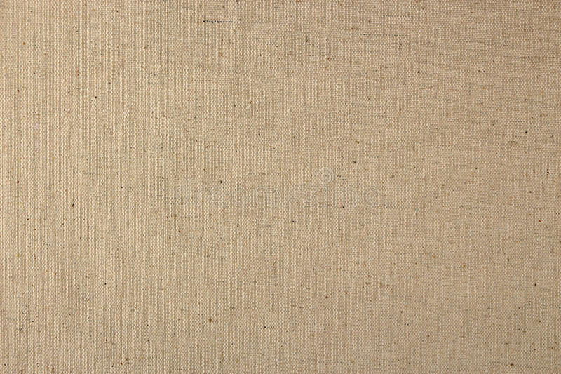 Natural Linen Fabric Background. Natural Tan Linen Fabric Textured Background in a Vertical Orientation royalty free stock photos