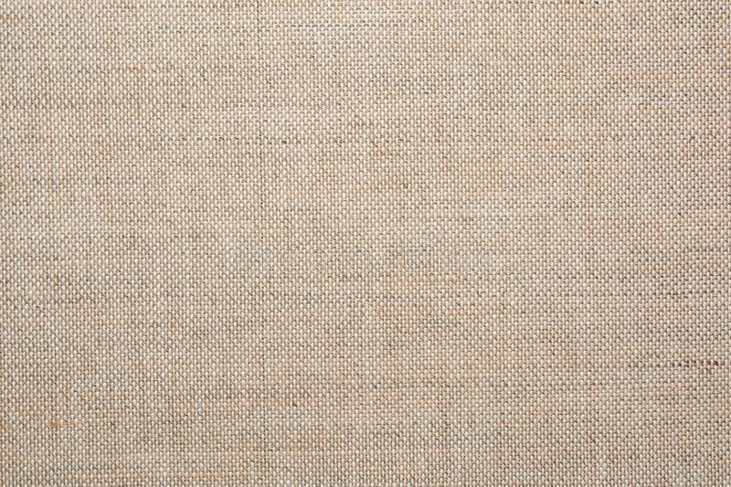 Texture of natural linen fabric. Natural linen fabric texture for backgrounds and design stock photos