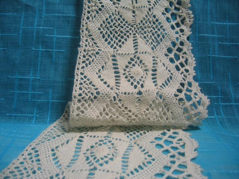 Natural linen  lace piece and woven. Natural linen turquoise and white, lace piece and woven, samples, art, background, backgrounds, beige, blue, celebration royalty free stock photo