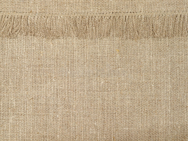 Natural linen texture pattern with fringe.Abstract background. Natural linen texture pattern with fringe suitable as abstract background royalty free stock photography