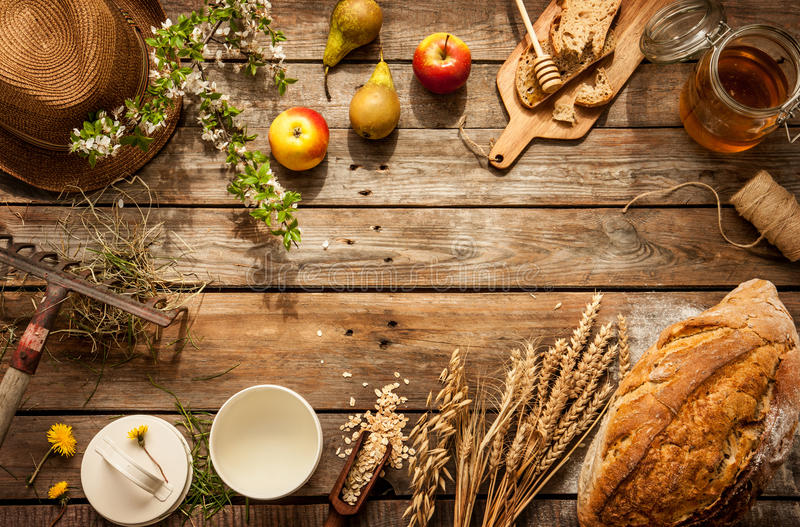 Natural local food products on vintage wooden table. Rustic composition captured from above. Country lifestyle, rural vacation or agritourism concept stock images