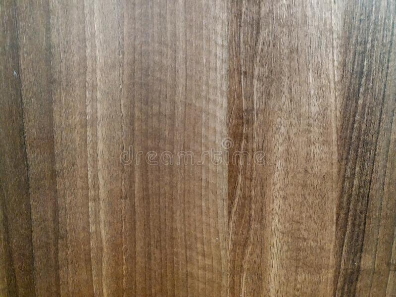 Natural looking brown wooden panel board used for doors, flooring, table desks and other surface coverage, with natural wooden. Pattern royalty free stock photos