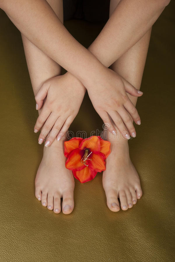 Natural manicure and pedicure with flower royalty free stock photos