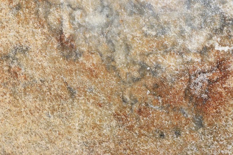 Natural marble background, natural natural texture of an ancient stone. It is used for finishing buildings and embankments, a fine background for a desktop and stock photography